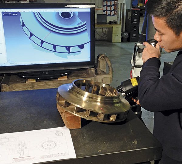 Image 2. An engineer verifies casting geometry to hydraulic design specifications.